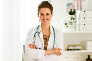 smiling medical doctor woman in office