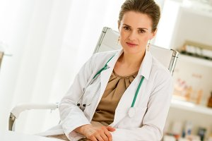 medical doctor woman sitting in office