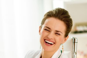 laughing medical doctor woman sitting in office