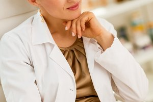 thoughtful medical doctor woman in office