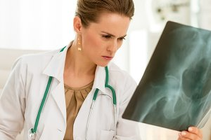 Medical doctor woman with fluorography in office