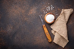 Culinary background with salt and knife