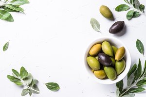 Black and green Olives  on white background.