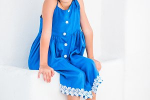 Girl in blue dresses having fun outdoors on Mykonos streets