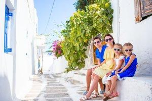 Family having fun outdoors on Mykonos streets