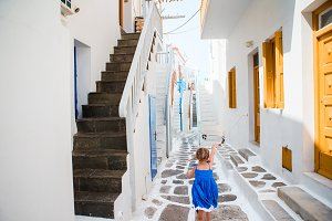 Girl in dresses having fun outdoors on Mykonos streets