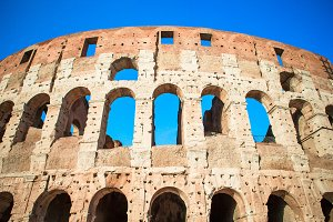 Colosseum or Coliseum background blue sky in Rome