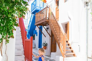 Adorable girl outdoors in greek village.