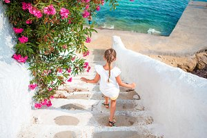 Adorable girl having fun outdoor in Greece