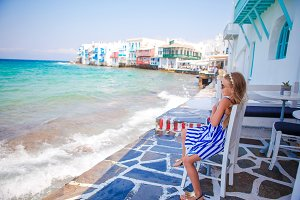 Adorable little girl at Little Venice the most popular tourist area on Mykonos island