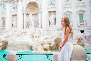 Adorable little girl background Trevi Fountain, Rome, Italy.