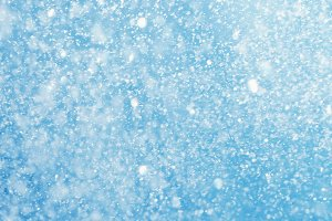 falling snow blue blurred background