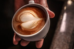 Barista create latte art