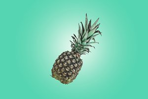 Pineapple on green pastel