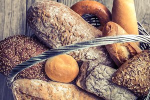 a basket of a variety of fresh bread