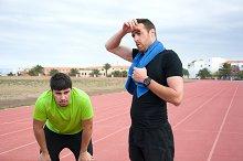 Two runner men resting