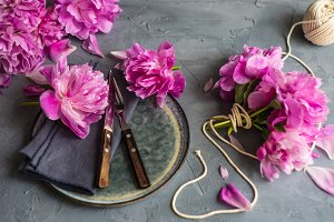 Spring table setting with peonies