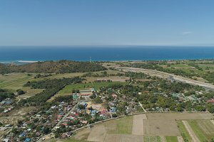 Town and farm fields near the sea.