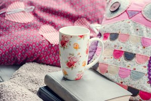 Cup of coffee or tea with books