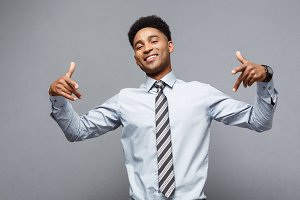 Business Concept - Confident happy young African American pointing two hands to himself.