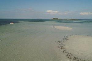 Tropical island Tanduyong with beach.