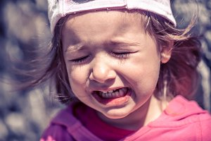 little girl crying, tears close-up.
