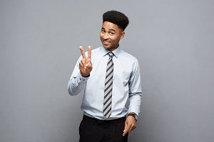 Business Concept - portrait of African American holding two peace or two fingers sign.
