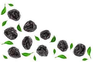 Dried plum - prunes with leaves isolated on a white background with copy space for your text. Top view. Flat lay
