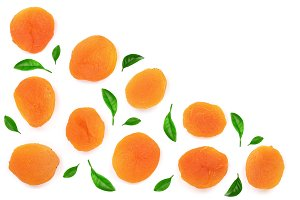 Dried apricots decorated with leaves isolated on a white background with copy space for your text. Top view. Flat lay