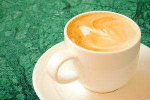 Cup of latte or cappuccino coffee