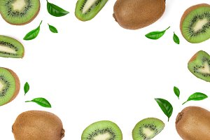 Kiwi fruit with slices and leaf isolated on white background with copy space for your text. Top view. Flat lay pattern