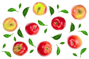 red apples decorated with green leaves isolated on white background top view. Flat lay pattern