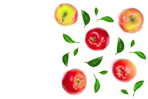 red apples decorated with green leaves isolated on white background with copy space for your text, top view