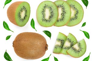 sliced kiwi fruit decorated with green leaves isolated on white background. Flat lay pattern. Top view