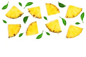 Sliced pineapple decorated with green leaves isolated on white background with copy space for your text. Top view
