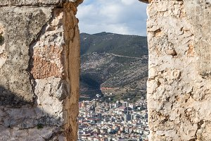 Window in a medieval castle wall with the view over Mediterranea