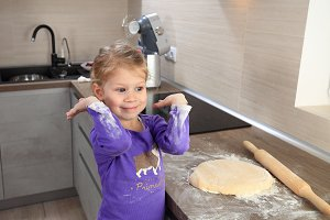 Cheerful little girl in kitchen