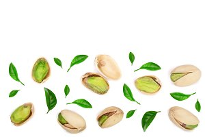 Pistachios with leaves isolated on white background with copy space for your text, top view. Flat lay pattern