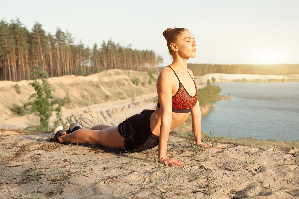 Sports Stock Photos: andreonegin market - Young woman in red sport top practicing yoga in beautiful nature. Meditation in morning sunny day