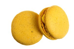 yellow macaroon isolated on white background without a shadow closeup. Top view. Flat lay