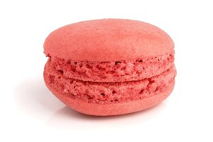 red macaroon isolated on white background closeup