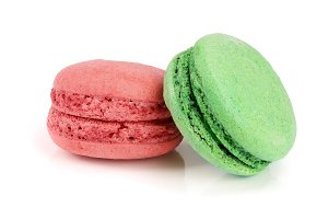 green and red macaroon isolated on white background closeup