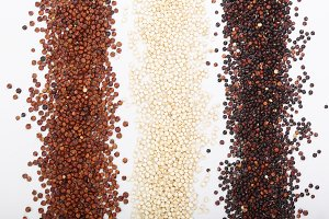Black red and white quinoa seeds isolated on white background. Top view