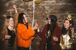 Happy girls having fun in the club
