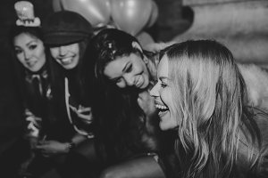 Happy girls having fun in the club