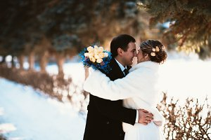 Winter bright wedding bride and groom couple