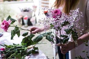 The florist makes a bouquet