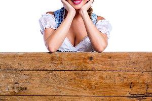 Woman in traditional bavarian clothes, Oktoberfest. Studio shot,