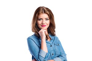 Woman in denim shirt, studio shot, white background, isolated