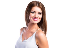 Young beautiful woman in white top, studio shot, isolated